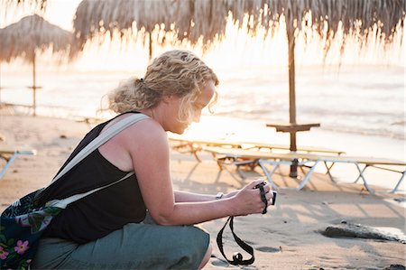 Woman on beach looking at camera Stock Photo - Premium Royalty-Free, Code: 6102-07790136