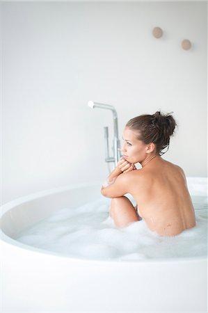 Young woman having bath Stock Photo - Premium Royalty-Free, Code: 6102-07843060