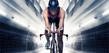 front - Woman cycling through tunnel Stock Photo - Premium Royalty-Free, Code: 6102-07843606