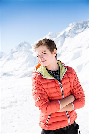 Young man in mountains looking away Stock Photo - Premium Royalty-Free, Code: 6102-07843755