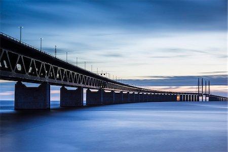 forward - Bridge at dusk, low angle view Stock Photo - Premium Royalty-Free, Code: 6102-07843736