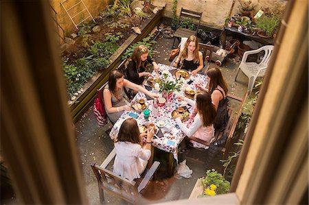 recreation - Teenage girls having meal on courtyard Stock Photo - Premium Royalty-Free, Code: 6102-07843961