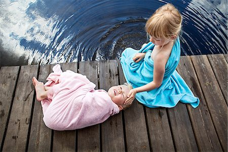 dece11 - Brother and sister wrapped in towels on jetty Stock Photo - Premium Royalty-Free, Code: 6102-07844020
