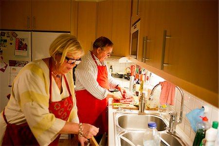 Senior couple in kitchen Stock Photo - Premium Royalty-Free, Code: 6102-07844115