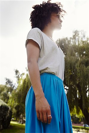 day - Young woman looking away Stock Photo - Premium Royalty-Free, Code: 6102-07844129