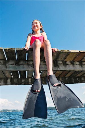 preteen girls bath - girl wearing flippers on jetty Stock Photo - Premium Royalty-Free, Code: 6102-08063041