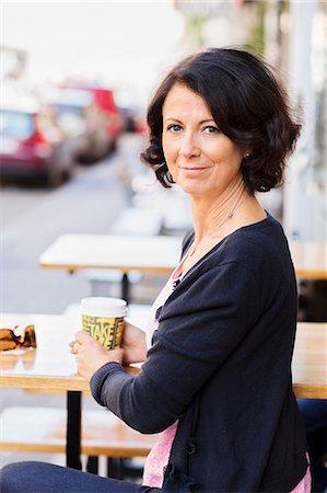 Smiling mature woman, portrait Stock Photo - Premium Royalty-Free, Code: 6102-08063133