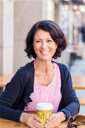 Smiling mature woman, portrait Stock Photo - Premium Royalty-Free, Code: 6102-08063135