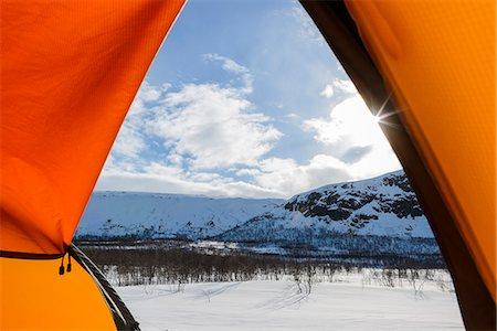 Winter landscape seen through tent entrance Stock Photo - Premium Royalty-Free, Code: 6102-08000550