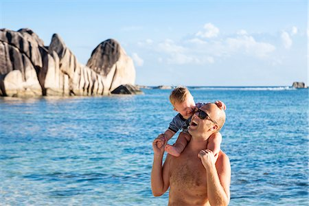 father son shirtless - Father with baby son on tropical beach Stock Photo - Premium Royalty-Free, Code: 6102-08000627