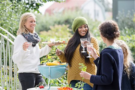 Friends having party outdoors Stock Photo - Premium Royalty-Free, Code: 6102-08000719