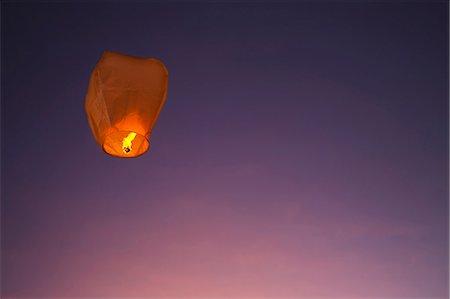 Paper lantern against sky Stock Photo - Premium Royalty-Free, Code: 6102-08000819