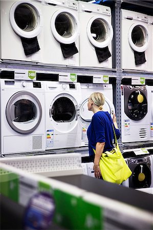 shop - Woman looking at washing machines in shop Stock Photo - Premium Royalty-Free, Code: 6102-08000832