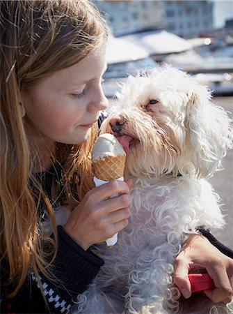 Girl and dog eating ice-cream together Stock Photo - Premium Royalty-Free, Code: 6102-08001342