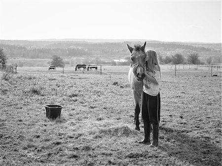 preteen kissing - Girl with horse on pasture Stock Photo - Premium Royalty-Free, Code: 6102-08001346