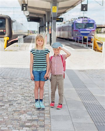 Brother and sister on train station Stock Photo - Premium Royalty-Free, Code: 6102-08001456