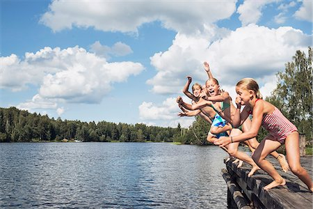 preteen girl topless - Boys and girls jumping into water Stock Photo - Premium Royalty-Free, Code: 6102-08001458