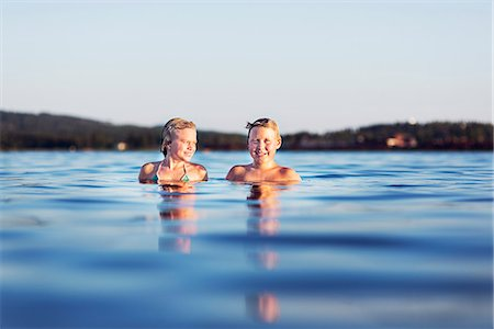 preteen girls bath - Girl and boy in lake Stock Photo - Premium Royalty-Free, Code: 6102-08001464