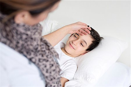 Mother checking sons temperature Stock Photo - Premium Royalty-Free, Code: 6102-08168907