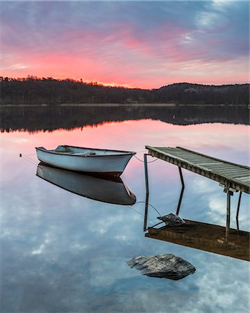 Rowboat moored at jetty, sunset Stock Photo - Premium Royalty-Free, Code: 6102-08169076