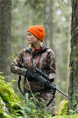 Woman hunting in forest Stock Photo - Premium Royalty-Free, Code: 6102-08184075