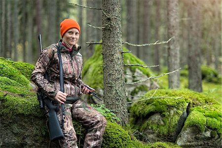Woman hunting in forest Stock Photo - Premium Royalty-Free, Code: 6102-08184078