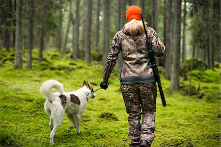 Woman with hunting dog in forest Stock Photo - Premium Royalty-Free, Code: 6102-08184083
