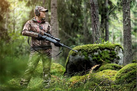 Woman hunting in forest Stock Photo - Premium Royalty-Free, Code: 6102-08184081