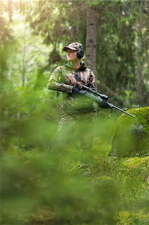 Woman hunting in forest Stock Photo - Premium Royalty-Free, Code: 6102-08184082