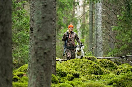 Woman with hunting dog in forest Stock Photo - Premium Royalty-Free, Code: 6102-08184084