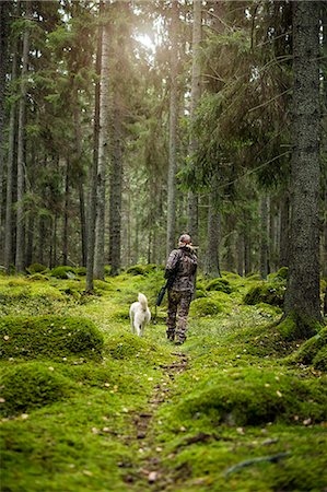 Woman with hunting dog in forest Stock Photo - Premium Royalty-Free, Code: 6102-08184085