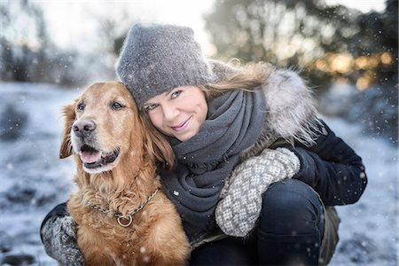 dog and woman and love - Portrait of smiling woman with dog Stock Photo - Premium Royalty-Free, Code: 6102-08184094