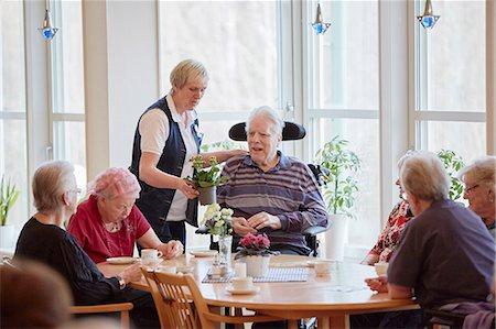 Senior people having coffee in care home Stock Photo - Premium Royalty-Free, Code: 6102-08184218