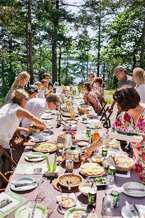 Family having meal outdoors Stock Photo - Premium Royalty-Free, Code: 6102-08120093
