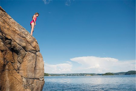 Girl standing on cliff Stock Photo - Premium Royalty-Free, Code: 6102-08120540