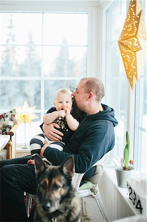 dog kissing man - Father with baby boy Stock Photo - Premium Royalty-Free, Code: 6102-08120520