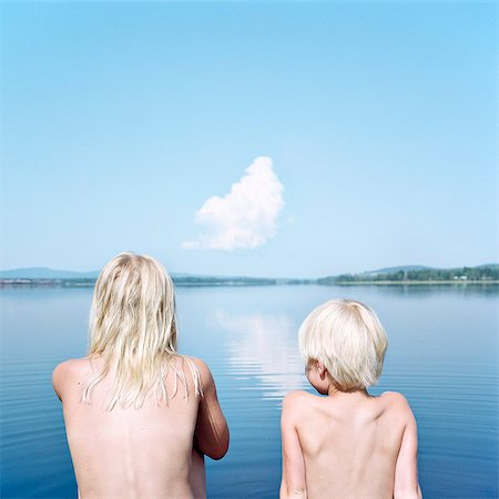 preteen girl topless - Boy and girl looking at water Stock Photo - Premium Royalty-Free, Code: 6102-08120531