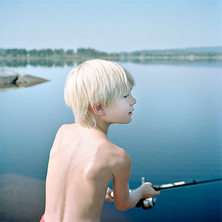Boy fishing Stock Photo - Premium Royalty-Free, Code: 6102-08120534