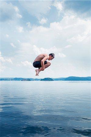 Man jumping into sea Stock Photo - Premium Royalty-Free, Code: 6102-08120539