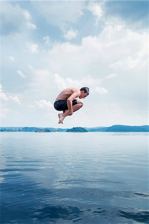 Man jumping into sea Stock Photo - Premium Royalty-Free, Code: 6102-08120539