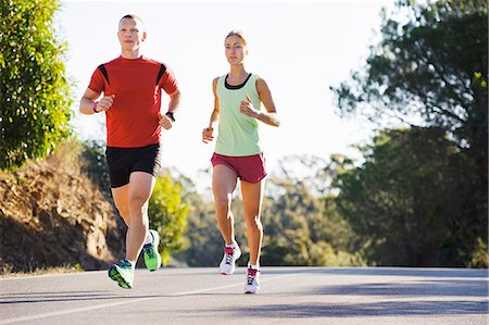 exercising - Young couple jogging Stock Photo - Premium Royalty-Free, Code: 6102-08120697