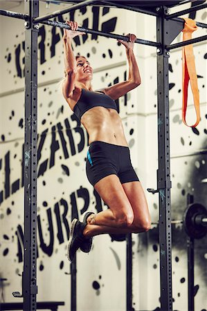 Woman training in gym Stock Photo - Premium Royalty-Free, Code: 6102-08120757