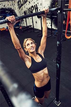 Woman training in gym Stock Photo - Premium Royalty-Free, Code: 6102-08120761