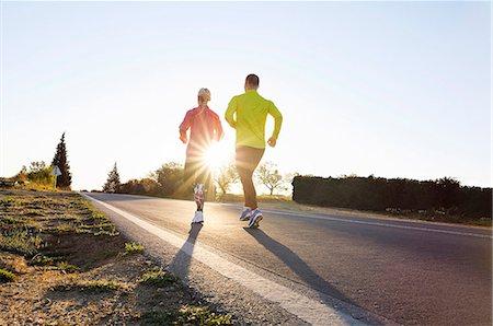 forward - Couple jogging Stock Photo - Premium Royalty-Free, Code: 6102-08120702