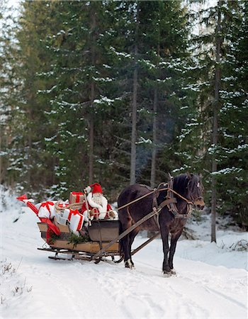 Santa in sled Stock Photo - Premium Royalty-Free, Code: 6102-08120893