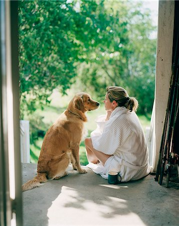 Woman sitting with dog Stock Photo - Premium Royalty-Free, Code: 6102-08120891