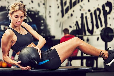 Woman training in gym Stock Photo - Premium Royalty-Free, Code: 6102-08120801