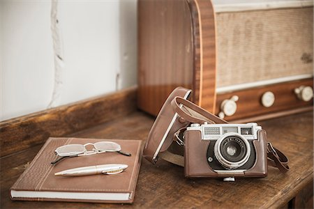 Still life with vintage camera Stock Photo - Premium Royalty-Free, Code: 6102-08120934