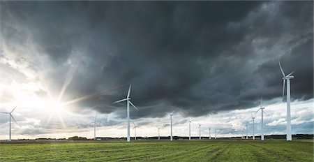 Wind turbines under stormy sky Stock Photo - Premium Royalty-Free, Code: 6102-08270868