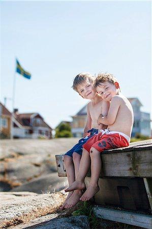 Boys sitting  together Stock Photo - Premium Royalty-Free, Code: 6102-08271046